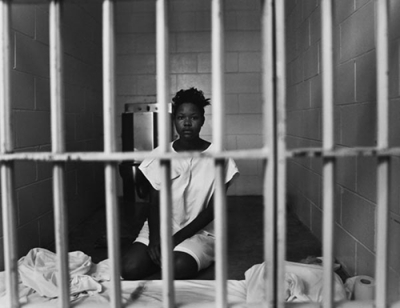 http://theindustrycosign.files.wordpress.com/2011/07/prison-woman.jpg